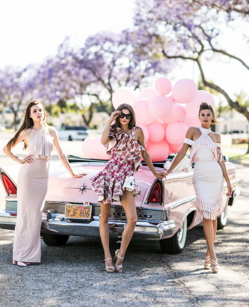 Three Women Near Pink Car with Pink Balloons