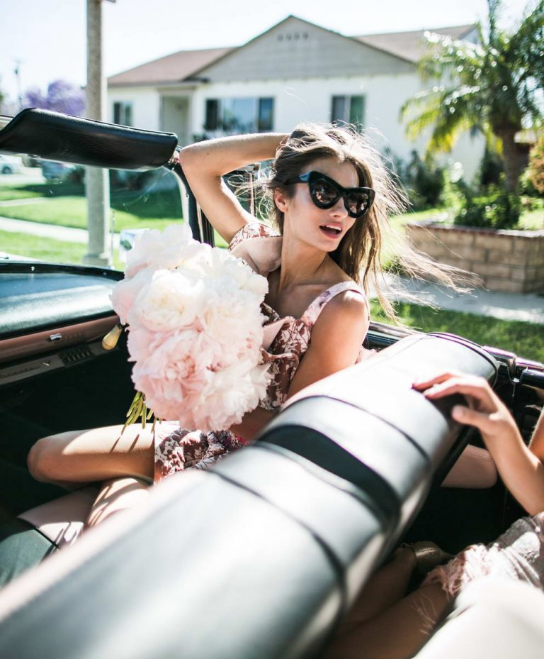 Women in A Car with Flowers on A Photo Shoot