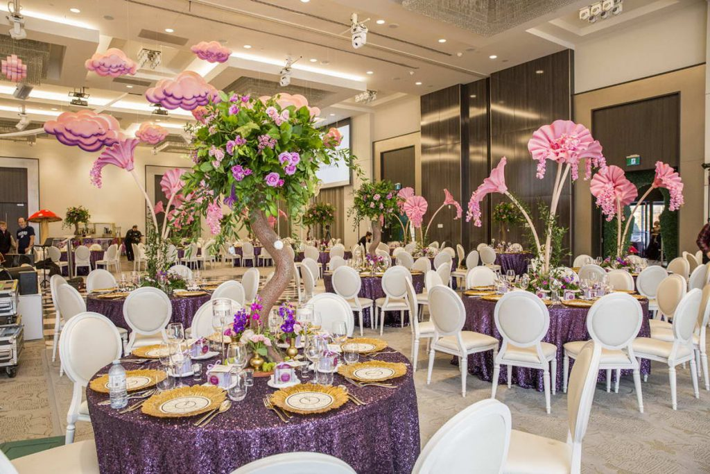 Purple Tables and Decoration Flowers Photo