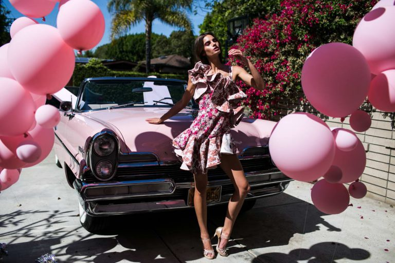 Women in A Pink Dress Beside Pink Car