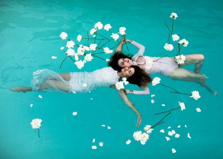 Two Women with Flowers in The Pool