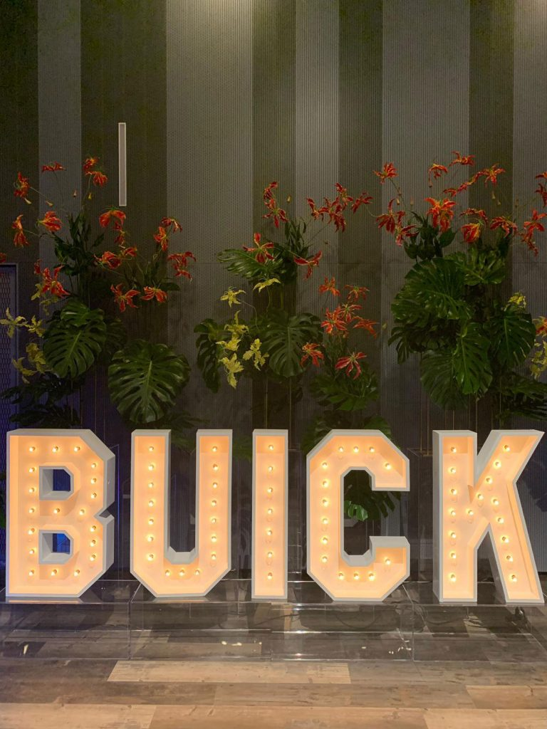 Buick Foam Prop with Flowers in The Background